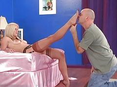 Sexy Blonde Gives Footjob