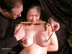 Busty asian bdsm and needle...