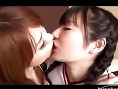 Asian Girl Kissing And...